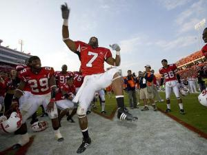 Wolfpack safety DaJuan Morgan and teammates celebrate after a close win against the Carolina Tar Heels.