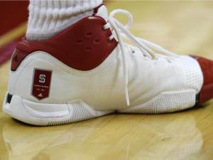 FILE: N.C. State Adidas basketball shoes with a banner for the two national championships won by the Wolfpack in 1974 and 1983.