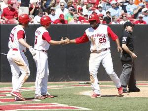 Pratt Maynard and Harold Riggins celebrate after scoring during the UNC vs. NC State baseball game on April 17th, 2011 at Doak Field in Raleigh, North Carolina.