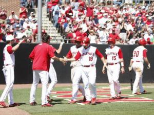 NC State celebrates after scoring several runs in the sixth inning of the UNC vs. NC State baseball game on April 17th, 2011 at Doak Field in Raleigh, North Carolina.