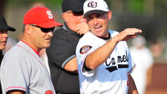 Greg Goff (right) and Elliott Avent (left) speak before the Campbell University vs. North Carolina State University NCAA baseball game in Buies Creek, N.C. Tuesday April 17, 2012.