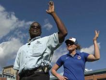 Ken Smith 'shakes it' with Durham Bulls dancers