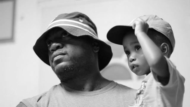 Howard in a Bulls hat with his son, Bakari (Photo by Roni Nicole Henderson)