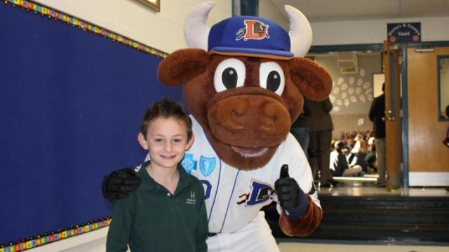 The Durham Bulls' mascot Wool E. Bull visited Immaculata School in Durham on Friday morning to donate $500 to Cooper Wiese.