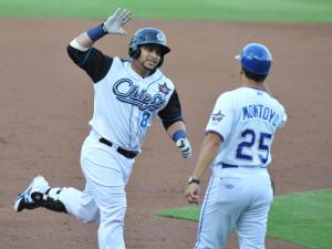 Jhonatan Solano (8) is all smiles as he rounds third base after hitting a home run during Triple-A All Star Game action at the Durham Bulls Athletic Park on July 16, 2014 in Durham, NC. (Will Bratton/WRAL contributor)