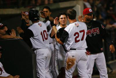 The team congratulates players for scoring during the Carolina MudCats game against the Lynchburg Hillcats on family night.  The MudCats beat the Hillcats 4-1 Friday night (photo by Wes Hight).