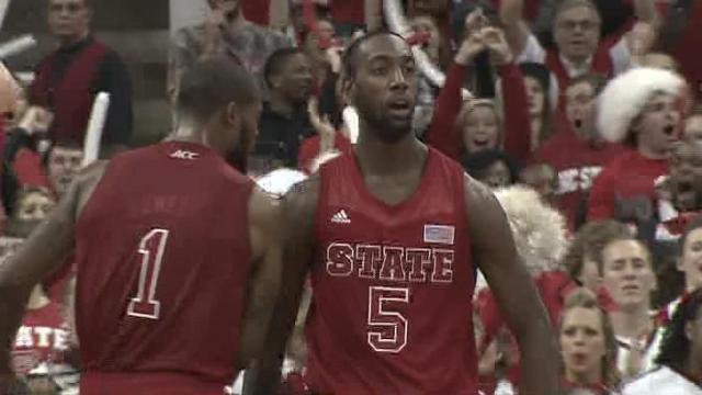 NC State celebrates, UNC shakes head