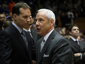 North Carolina coach Roy Williams greets the Duke coaching staff prior to the Tar Heels' 88-70 win at Duke on Saturday, March 3, 2012 in Durham, NC (photo by Jack Morton).