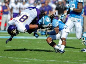 North Carolina Tar Heels safety Tre Boston #10 tackles East Carolina Pirates wide receiver Justin Jones #84 .North Carolina defeats East Carolina 27-6 at Kenan Stadium in Chapel Hill North Carolina.