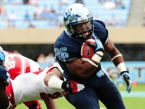 Gio Bernard (26) scores a touchdown during the North Carolina Tar Heels vs. N.C. State Wolfpack NCAA football game, Saturday, October 27, 2012 in Chapel Hill, N.C.
