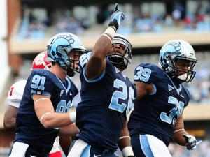 Gio Bernard (26) reacts after scoring a touchdown during the North Carolina Tar Heels vs. N.C. State Wolfpack NCAA football game, Saturday, October 27, 2012 in Chapel Hill, N.C.