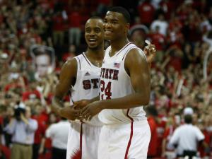 Lorenzo Brown (2) and T.J. Warren (24) begin to celebrate a victory during the Duke vs. NC State game on January 12, 2013 in Raleigh, North Carolina.