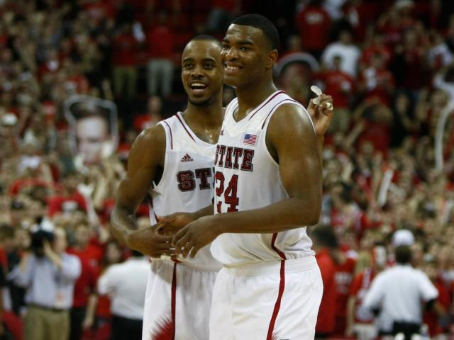 Lorenzo Brown (2) and T.J. Warren (24) begin to celebrate a victory during the Duke vs. NC State game on January 12, 2013 in Raleigh, North Carolina. <br/>Photographer: Jerome Carpenter