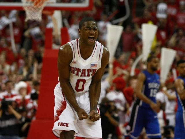 Rodney Purvis (0) gets fired up after a dunk during the Duke vs. NC State game on January 12, 2013 in Raleigh, North Carolina. <br/>Photographer: Jerome Carpenter