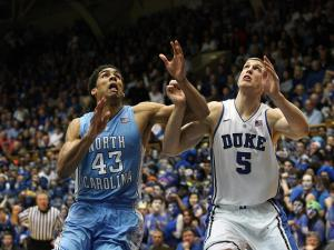 North Carolina's James Michael McAdoo and Duke's Mason Plumlee during the Duke Blue Devils' 73-68 victory over North Carolina on Wednesday, February 13, 2013 in Durham, NC (Photo by Jack Morton).