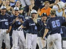 North Carolina got 8.1 shutout innings from starter Hobbs Johnson and three RBIs from shortstop Michael Russell Thursday night as they eliminated North Carolina State from the College World Series with a 7-0 victory. The Tar Heels  advance to play UCLA Friday night at 8 p.m.