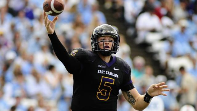 ECU quarterback Shane Carden (5) drops back to pass during play at Kenan Stadium between the University of North Carolina Tar Heels and the East Carolina Pirates on Septempber 28, 2013 in Chapel Hill, NC.
