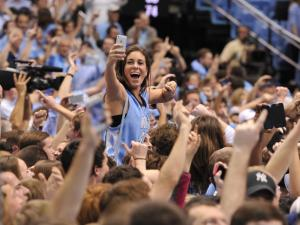 UNC fans rush the court following following action at the Dean E. Smith Center between the North Carolina Tar Heels and the Duke Blue Devils on February 20, 2014 in Chapel Hill, NC. (Will Bratton/WRAL contributor)