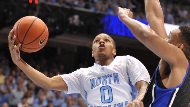 Nate Britt (0) goes up for a shot during action at the Dean E. Smith Center between the North Carolina Tar Heels and the Duke Blue Devils on February 20, 2014 in Chapel Hill, NC. (Will Bratton/WRAL contributor)