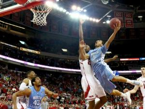Marcus Paige (5) hits the game winner in overtime.  NC State lost to UNC in overtime, 85-84, on February 26, 2014 at the PNC arena in Raleigh, North Carolina. Photo by: Jerome Carpenter
