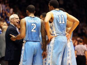 North Carolina coach Roy Williams and his team during the Tar Heels' game versus Duke on Saturday, March 8, 2014 in Durham, NC.  Duke defeated the Tar Heels 93-81.