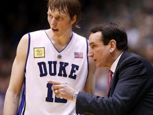 Duke head coach Mike Krzyzewski talks with Kyle Singler on February 4, 2010.