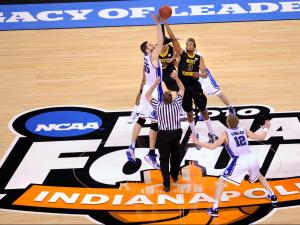 West Virginia and Duke tip the ball at Lucas Oil Stadium in Indianapolis at the start of their NCAA Final Four game on April 3, 2010. (Matt Detrich / The Star) West Virginia faced Duke in the second semi-final game of the NCAA Final Four Division I Men's Championships at Lucas Oil Stadium in Indianapolis Saturday, April 3, 2010.