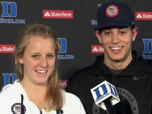 Olympic medalists and Duke University teammates Abby Johnston and Nick McCrory address reporters upon their return from London on Aug. 13, 2012.