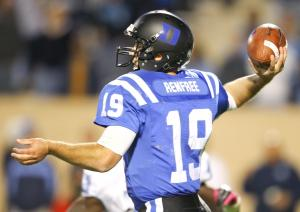 Duke's #19 Sean Renfree passes the ball as Duke comes back to defeat UNC 33 to 30 Saturday night October 20, 2012. (Photo by Jack Tarr)