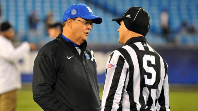 Duke Blue Devils head coach David Cutcliffe talks to a referee prior to a game against the Cincinnati Bearcats during the Belk Bowl at Bank of America Stadium on December 27, 2012 in Charlotte, North Carolina. (Photo by Lance King)