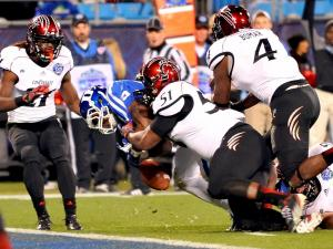 Cincinnati Bearcats linebacker Greg Blair #51 forces and recovers a fumble by Duke Blue Devils running back Jela Duncan #25 during the Belk Bowl at Bank of America Stadium on December 27, 2012 in Charlotte, North Carolina. (Photo by Lance King)