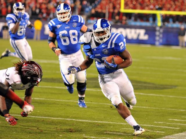 Duke Blue Devils running back Juwan Thompson #23 runs against the Cincinnati Bearcats during the Belk Bowl at Bank of America Stadium on December 27, 2012 in Charlotte, North Carolina. Cincinnati defeated Duke 48-34. (Photo by Lance King)