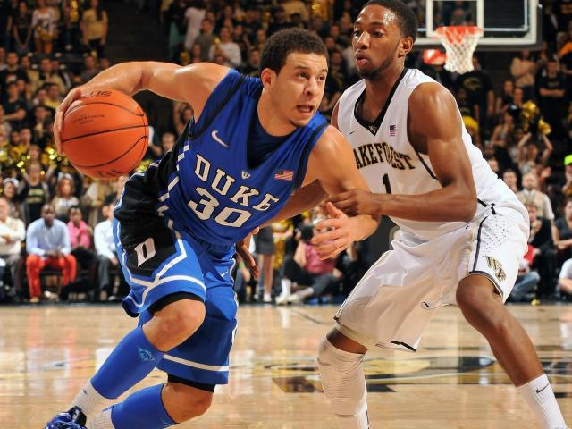 Duke Blue Devils guard Seth Curry (30) dribbles against Wake Forest Demon Deacons guard Madison Jones (1) at Lawrence Joel Coliseum on January 30, 2013 in Winston Salem, NC. (Photo by Lance King) <br/>Photographer: Lance  King