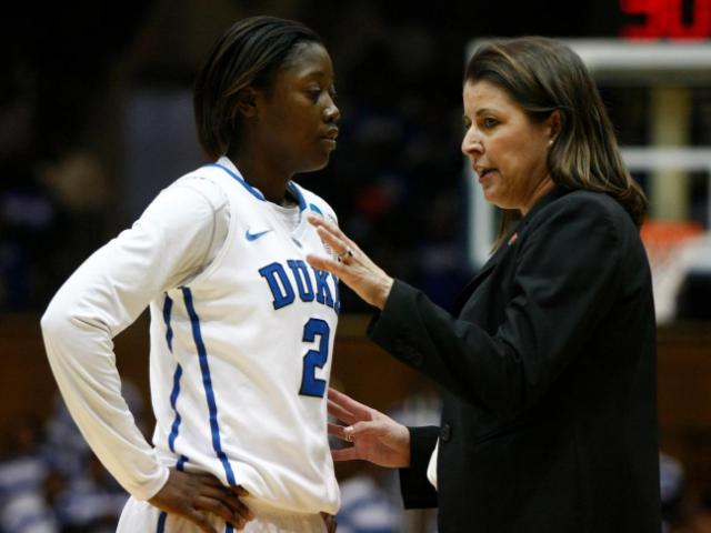 FILE: Coach Joanne McCallie talks with Alexis Jones (2) during the first round game of the NCAA Women&#039;s Basketball Tournament between Hampton and Duke in Durham, N.C., Sunday, March 24, 2013. <br/>Photographer: Jerome Carpenter
