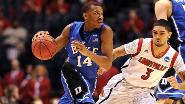 Rasheed Sulaimon #14 of the Duke Blue Devils dribbles against Peyton Siva #3 of the Louisville Cardinals during the Midwest Regional Final of the 2013 NCAA Men's Basketball Tournament at Lucas Oil Stadium on March 31, 2013 in Indianapolis, IN. Louisville defeated Duke 85-63. (Photo by Lance King)