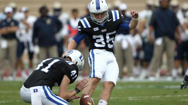 Ross Martin (35) boots in the extra point for Duke. Navy Midshipmen travel to Durham, N.C. for a Saturday boon game. Duke proves to have too much offense for Navy and prevails 35 to 7. Photo by CHRIS BAIRD