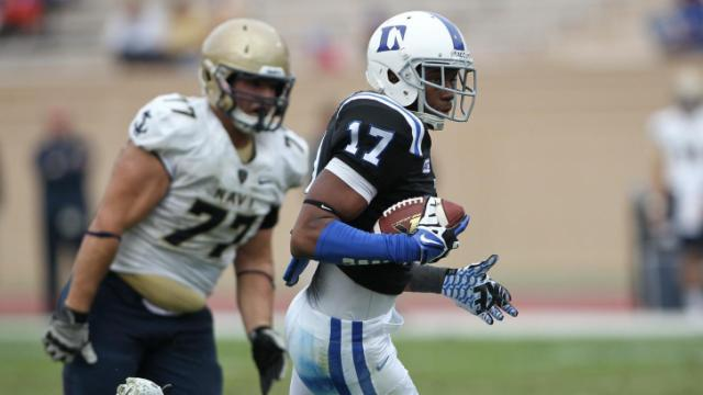 Issac Blakeney (17) with the carry for Duke. Navy Midshipmen travel to Durham, N.C. for a Saturday boon game. Duke proves to have too much offense for Navy and prevails 35 to 7. Photo by CHRIS BAIRD