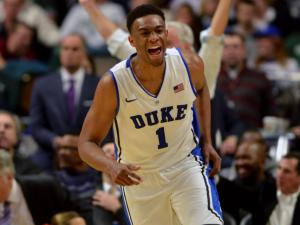 Duke Blue Devils forward Jabari Parker (1) reacts following a basket against the Kansas Jayhawks during the State Farm Champions Classic at the United Center on November 12, 2013 in Chicago, Illinois. (Photo by: Lance King)