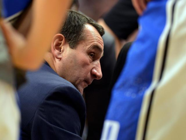 Duke Blue Devils Head Coach Mike Krzyzewski instructs his team during a time out against the Kansas Jayhawks during the State Farm Champions Classic at the United Center on November 12, 2013 in Chicago, Illinois. (Photo by: Lance King)<br/>Photographer: Lance  King