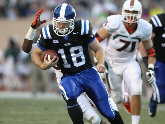 Brandon Connette (18) with the ball. The Miami Hurricanes face Duke at Wallace-Wade Stadium for a showdown of the 7-2 ACC teams. Photo by CHRIS BAIRD<br/>Photographer: Chris Baird