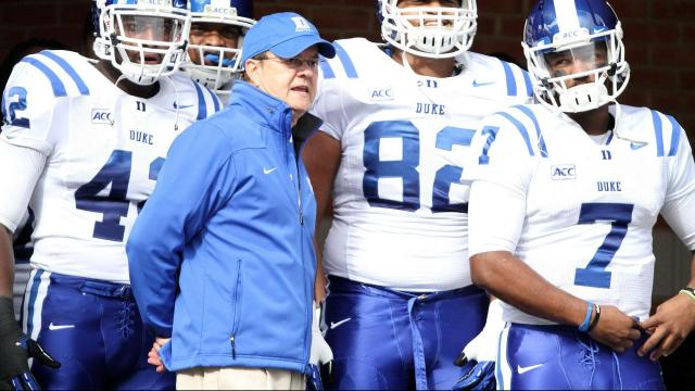 Duke coach David Cutcliffe and team prior to the Blue Devils' game versus Wake Forest on November 23, 2013 in Winston-Salem, NC.  Duke defeated Wake Forest 28-21 (Photo by Jack Morton).