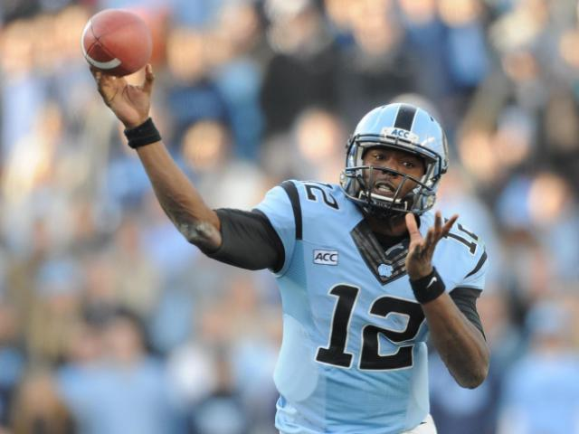 UNC quarterback Marquise Williams (12) drops back to throw a pass during action at Kenan Stadium between the University of North Carolina Tar Heels and the Duke University Blue Devils on November 30, 2013 in Chapel Hill, NC.