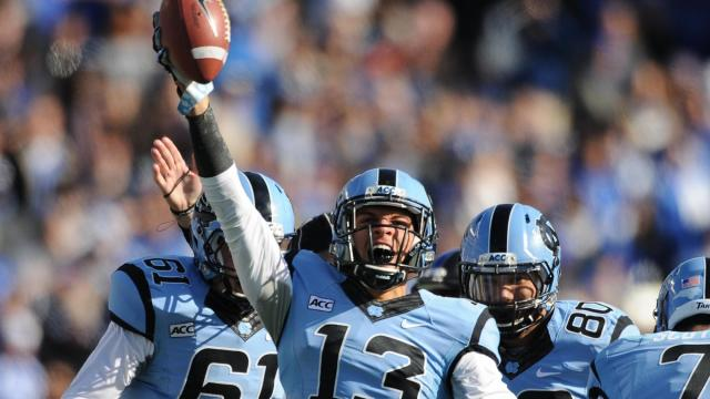 Mack Hollins (13) celebrates after recovering a fumbled Duke punt return during action at Kenan Stadium between the University of North Carolina Tar Heels and the Duke University Blue Devils on November 30, 2013 in Chapel Hill, NC.