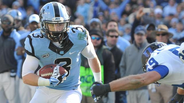 UNC wide receiver Ryan Switzer (3) shakes a defender during action at Kenan Stadium between the University of North Carolina Tar Heels and the Duke University Blue Devils on November 30, 2013 in Chapel Hill, NC.
