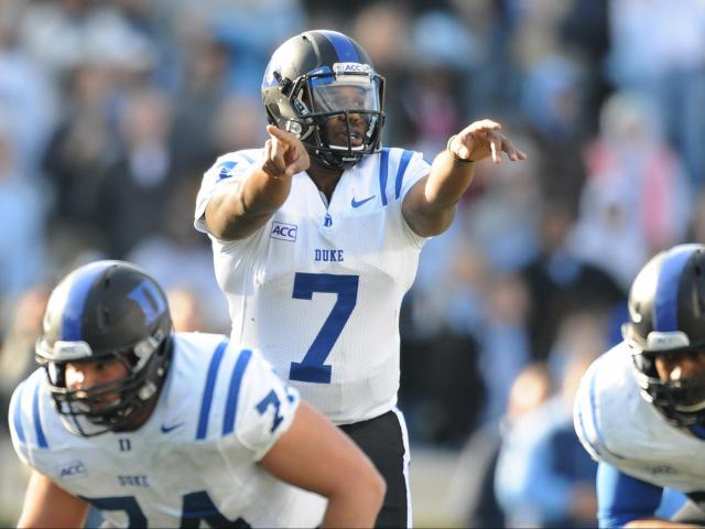 Duke quaterback Anthony Boone (7) makes a call at the line of scrimmage during action at Kenan Stadium between the University of North Carolina Tar Heels and the Duke University Blue Devils on November 30, 2013 in Chapel Hill, NC.