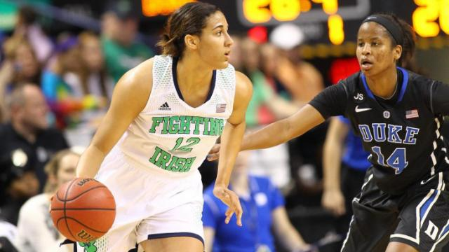 Notre Dame Fighting Irish forward Taya Reimer (12) looks for moves the ball around the key. Duke faces Notre Dame in the Women's ACC Championship game. Notre Dame over powers Duke in the second half and wins 69 to 53. (Chris Baird / WRAL Contributor).