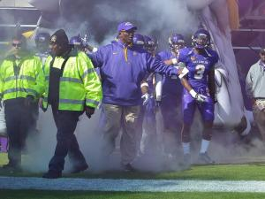 East Carolina Pirates head coach Ruffin McNeil leads the Pirates onto the field. (Photos By Anthony Barham)