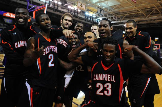 Members of the Campbell basketball team celebrate following the Campbell Camels vs. East Carolina Pirates NCAA basketball game, Wednesday, January 2, 2013 in Greenville, NC. <br/>Photographer: Will Bratton