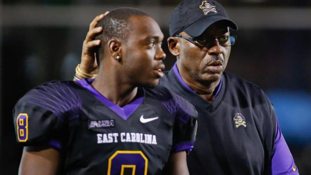 East Carolina Pirates Head Coach Ruffin McNeill and East Carolina Pirates wide receiver Cedric Thompson (8) during tonights game.East Carolina defeats Florida Atlantic 31-13 on Thursday, September 5, 2013 in Greenville, NC (Photos By Anthony Barham)