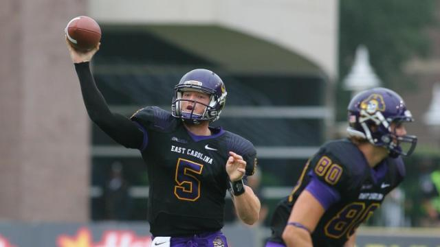 East Carolina Pirates quarterback Shane Carden (5) drops back to pass during todays game. East Carolina defeats Southern Miss 55-14 on Saturday, October 19, 2013 in Greenville, NC (Photos By Anthony Barham)